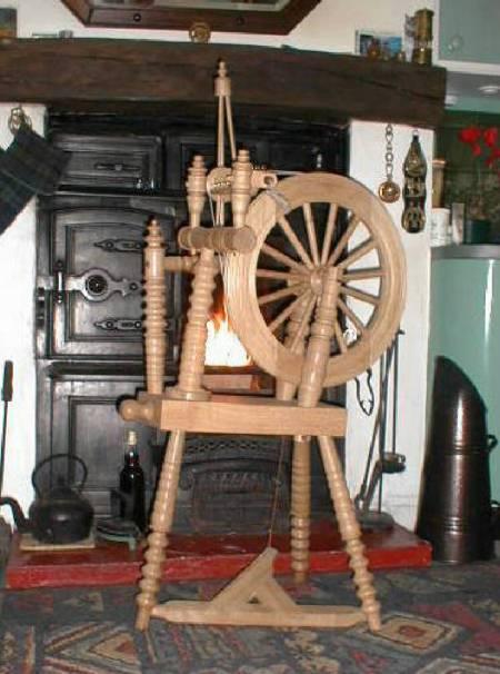 Spinning wheel turned on wood lathe